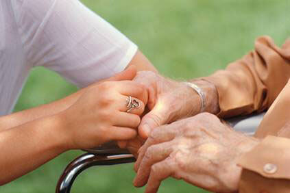 caregiver and patient holding hands