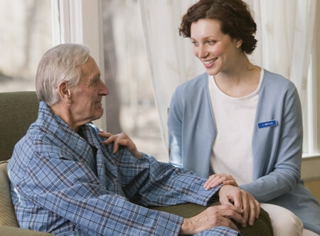nursing home caregiver with patient