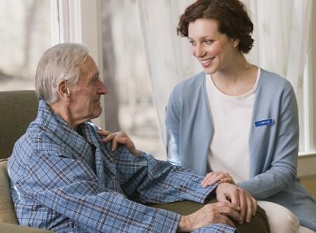 nursing home caregiver with patient
