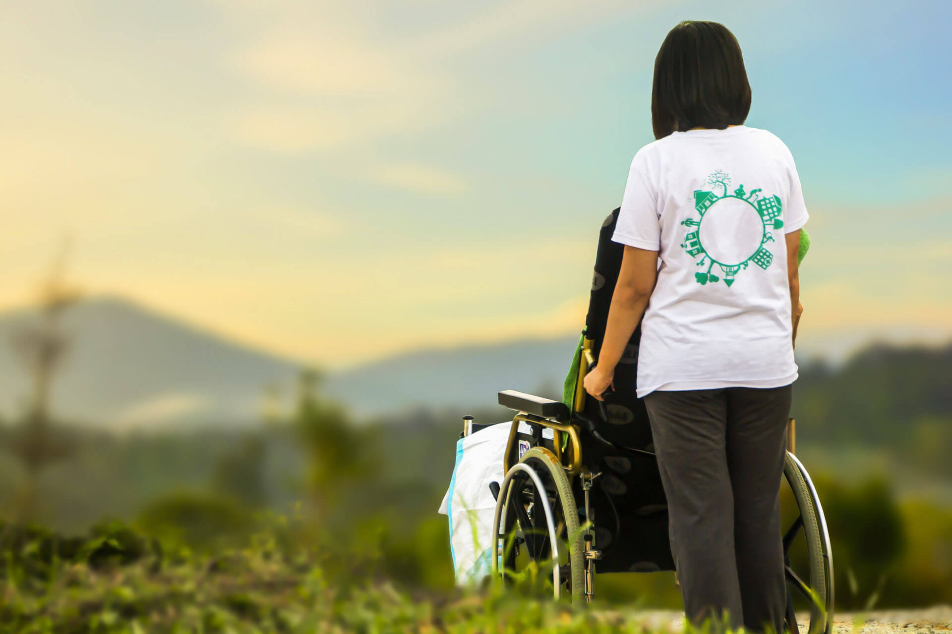 caregiver with wheelchair patient