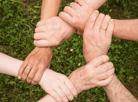 intertwined helping hands