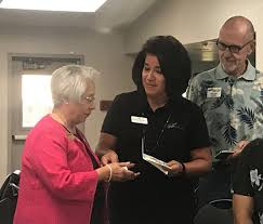 Phil and Susana donating to interfaith