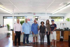 Shella board receiving Torch award