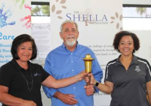 Shella Foundation receiving Torch award