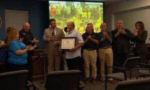 Michael receiving city award